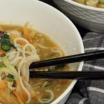 Healthy Ramen Noodles recipe in a white bowl with chopsticks