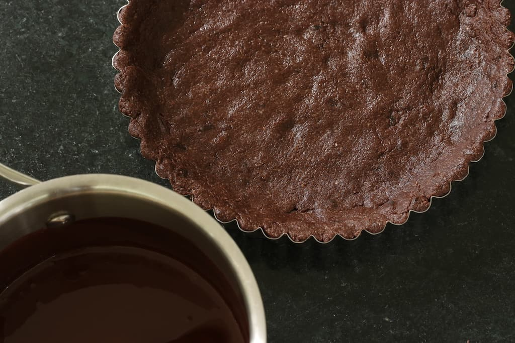 Crust pressed into pan for Vegan Chocolate Tart