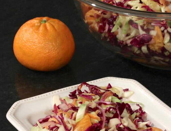 Bowl and serving of Coleslaw with Orange Ginger Vinaigrette