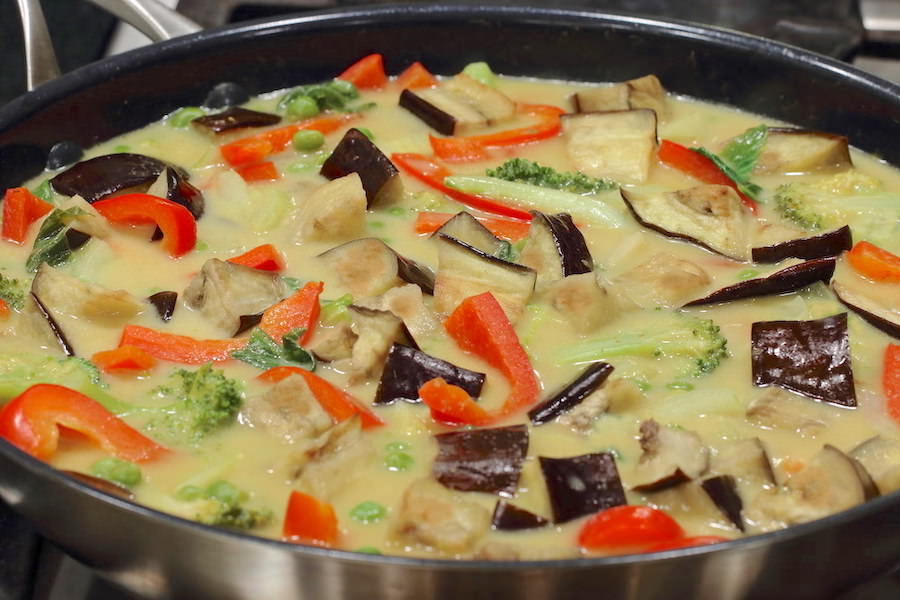 Vegetarian Thai Green Curry cooking in a large skillet