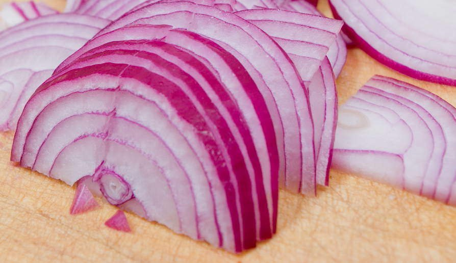 Sliced red onion on a cutting board