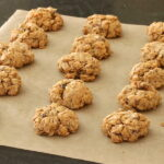Baked maple nut cookies on parchment paper