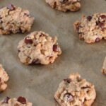 Baked chocolate chip cookies on parchment lined baking sheet