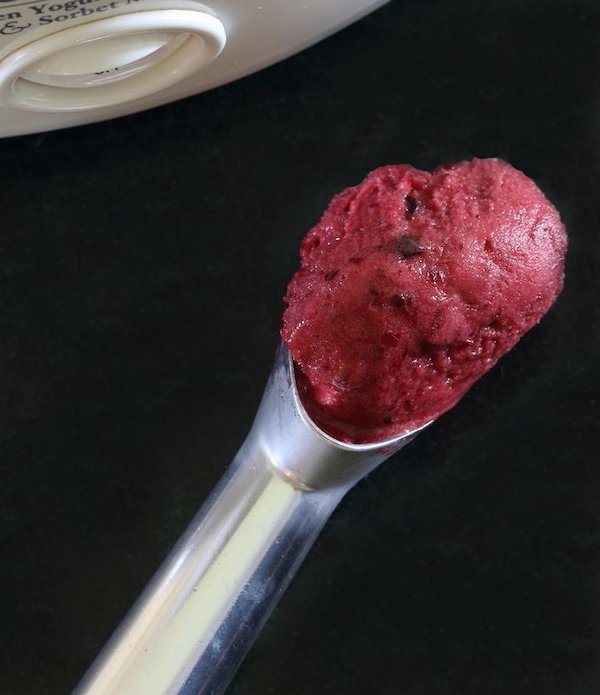 Scoop of cherry hibiscus dairy-free sorbet
