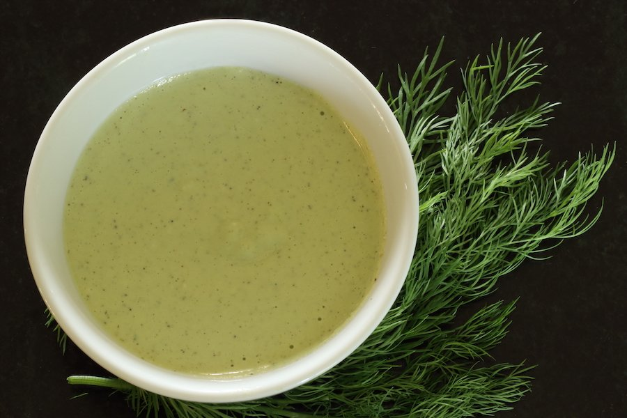 Cashew Dill dressing with sprigs of dill