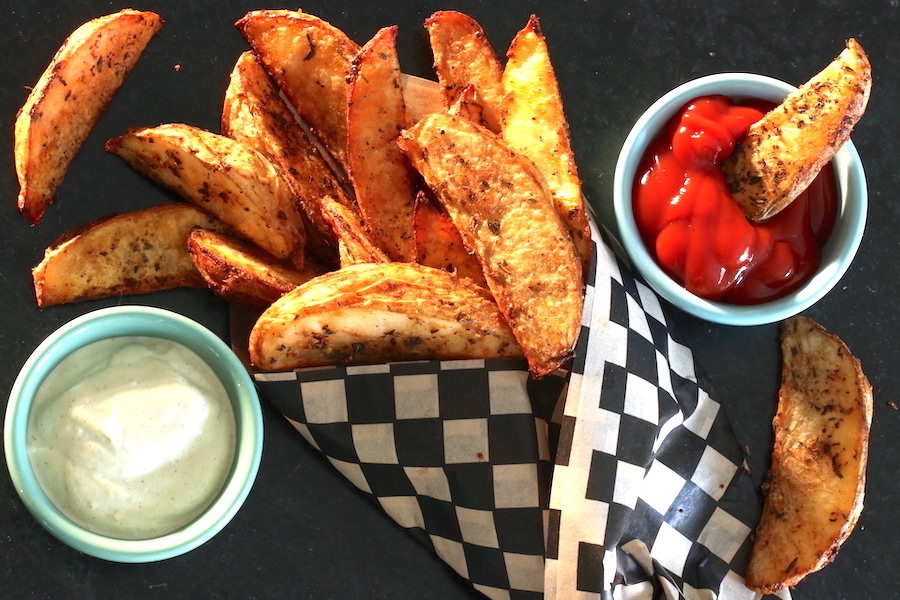 Potato Wedges served with ketchup and dill cashew dressing