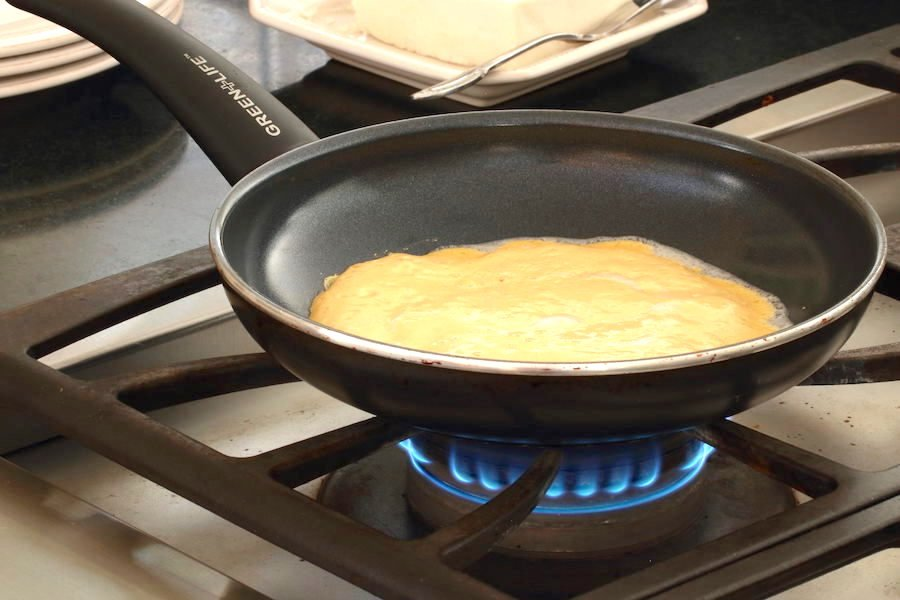 Omelette batter poured into pan