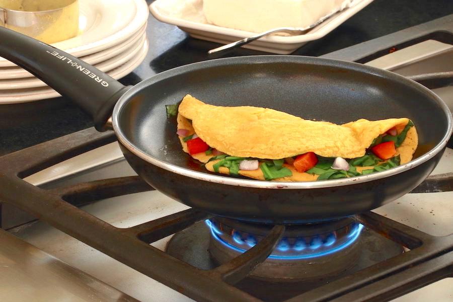 Omelette folded in half in pan