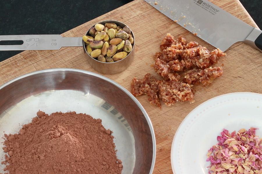 Cocoa powder, pistachios, minced dates, and rose petals