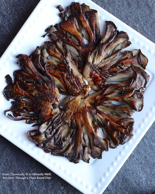 Maitake Mushroom cut into slabs and cooked until golden brown served on a square plate