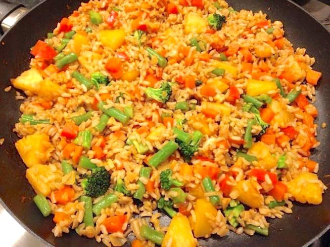 Pineapple fried rice cooked but still in the skillet