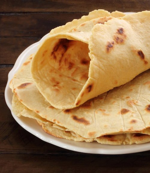 Three Potato Hummus Flatbreads – one rolled up to show how pliable they are