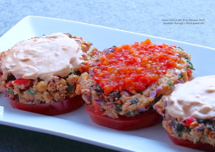 Three Quinoa Garbanzo Burgers on a rectangular dish –topped with dressings