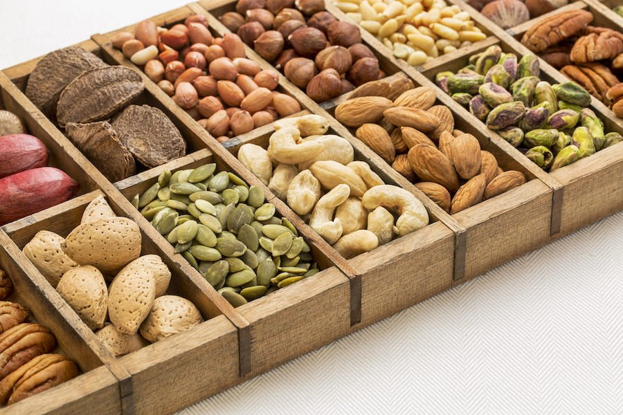 Display of seeds and nuts in wooden box