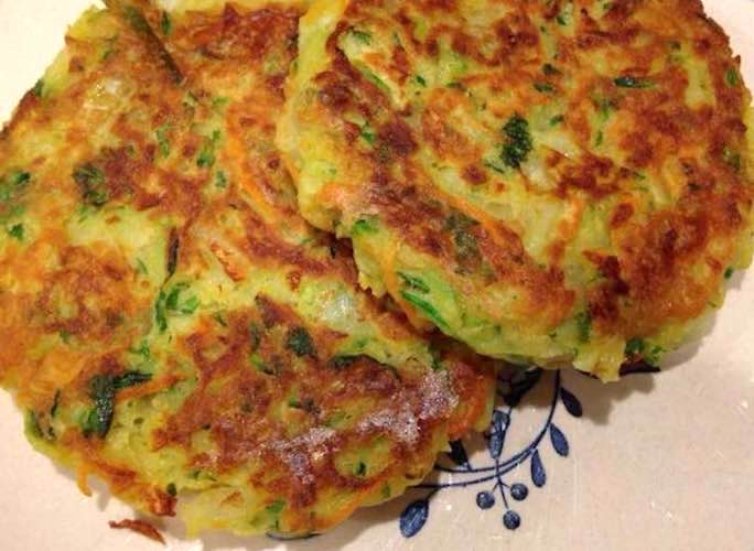 Close up of two Zucchini Pancakes on a plate