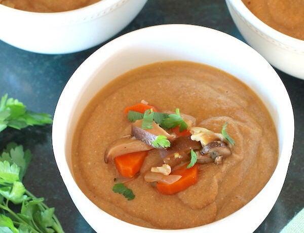 Cream of Mushroom Soup vegan served in white bowls