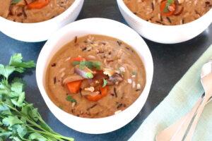 Three bowls of Vegan Cream of Mushroom Soup with Wild Rice