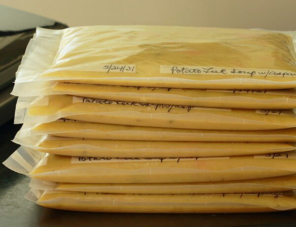 Flat packages of soup ready for the freezer