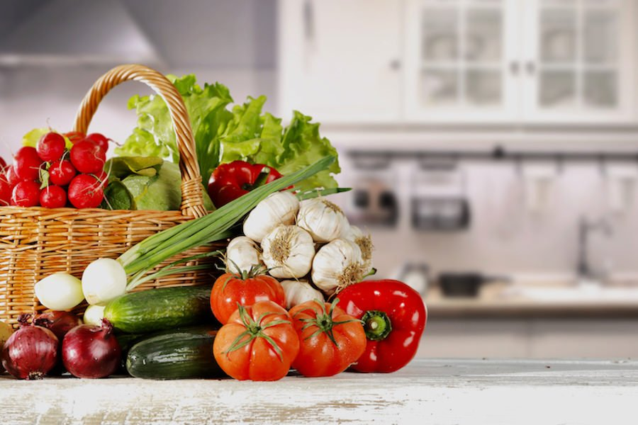 Display of vegetables in white kitchen