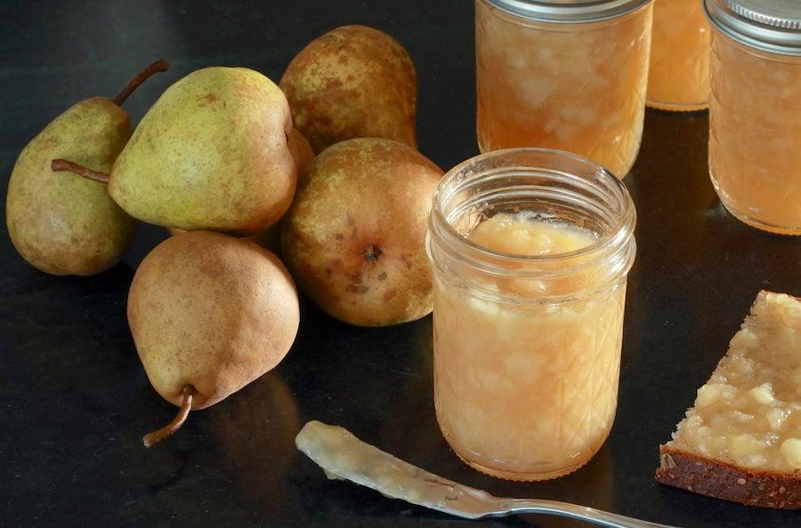 Half pint jars of pear jam; whole pears arranged to side