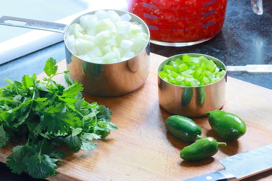 Prepping veggies for Roma Salsa